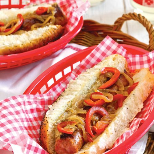 Conecuh hot dogs topped with peppers