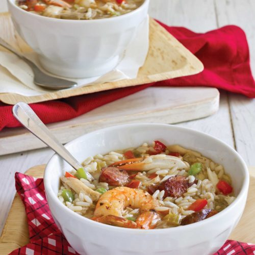 Conecuh sausage and seafood gumbo in a white bowl