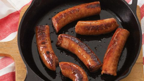 Conecuh Sausage sizzling in Cast Iron Pan
